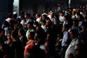 India blackout ends: Stranded passengers wait for power at New Delhi railway station