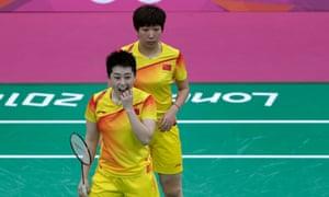 Yu Yang, left, and Wang Xiaoli of China, watch as the shuttlecock hits the net on 31 July 2012. Photograph: Saurabh Das/AP
