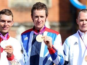 Bradley Wiggins poses on the podium