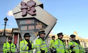 Police secure the Olympic countdown cloc