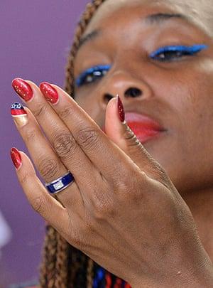 Nail art: US tennis player Venus Williams looks at