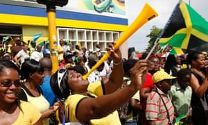 Jamaicans celebrate their country's clean sweep in the Olympic 200m final