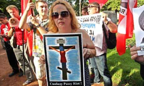 'Freedom for Pussy Riot' shows woman in balaclava on a cross