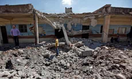 Syrians survey bombed school