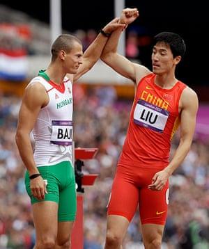 blunders gallery: China's Liu Xiang, right, and Hungary's Balazs Baji,