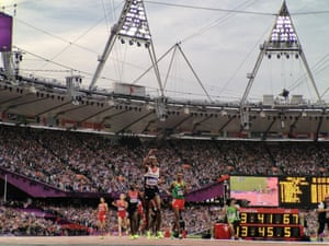 Team GB's Mo Farah crosses the line to win gold in the men's 5000m.