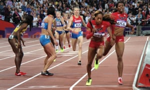 Sandra Richards Ross takes the baton for Team USA as they head to gold in the women's 4 x 400m relay at the Olympic stadium.