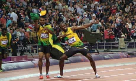Bolt (R) and Blake celebrate the Jamaican team's gold medal in the 4 x 100m men's relay - the final athletics event in the Olympic stadium.