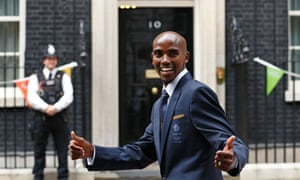 Mo Farah poses for pictures outside 10 Downing Street as he attends a 'hunger summit'
