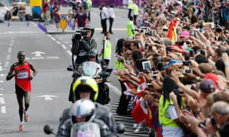 Uganda's marathon runner Stephen Kiprotich runs to gold