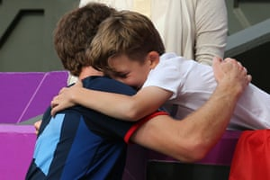 team GB celebrations: Eleven-year-old Henry Caplan from Essex hugs Andy Murray
