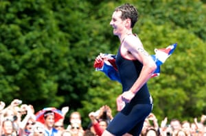 team GB celebrations: Gold medal-winning triathlete Alistair Brownlee runs with the flag