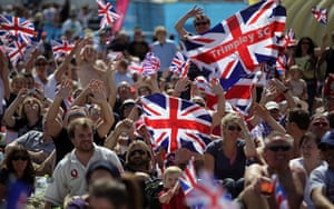 team GB celebrations: Crowds  on the Weymouth beach cheer as they watch Ben Ainslie