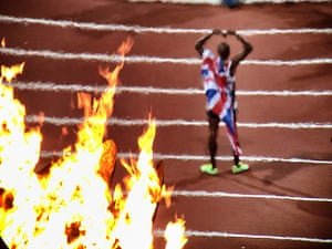 Guardian Bestpics: Mo Farah is seen through the heat of the Olympic flames