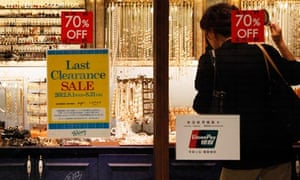 A woman shops in Tokyo. A fall in consumer spending has led to a slowdown in Japan's economic growth