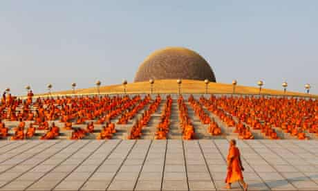 Buddhist monks pray while promoting world peace