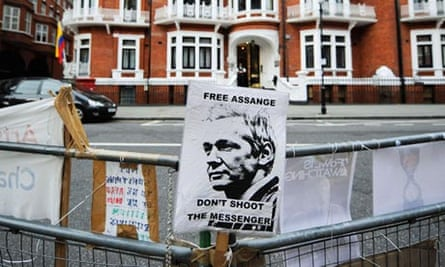 A sign reading 'Free Assange' is tied to a barrier opposite the Ecuadorian embassy in London