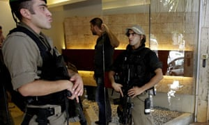 Lebanese police stand guard at the entrance of Michel Samaha's home in Beirut