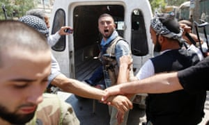 And a Free Syrian Army fighter reacts after hearing news that his commander had been killed by tank shell.
