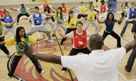 Dame Kelly Holmes (right) joins a dance class