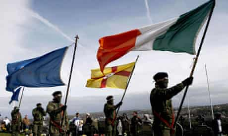 Masked members of the Real IRA holding flags