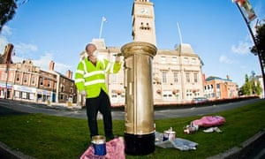 A Royal Mail postbox in Chorley being painted gold in honour of Bradley Wiggins