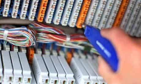 A BT engineer connects customers to a high-speed fibre-optic network