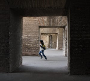 Your Pictures: Square: A girl running through the Colosseum in Rome