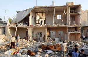 Syrian Conflict: Syrian Conflict: A man searches among houses in Azaz