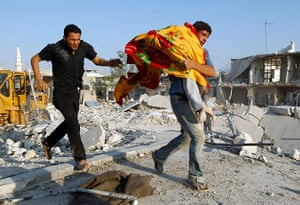 Syrian Conflict: Syrian Conflict: A man carries the body of a boy in Azaz