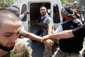 Syrian Conflict: A Free Syrian Army fighter reacts