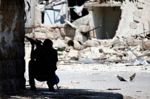 Syrian Conflict: A Free Syrian Army fighter aims his sniper rifle Aleppo