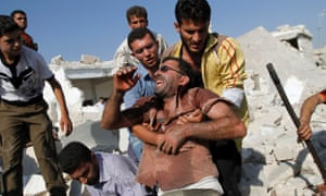 A Syrian man reacts after seeing the body of his relative buried in rubble after an air strike destroyed at least ten houses in the town of Azaz on the outskirts of Aleppo, Syria, Wednesday, Aug. 15, 2012. (AP Photo/ Khalil Hamra)