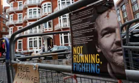 Protest posters on police barriers outside the Ecuadorian embassy