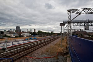 London Legacy: Photo of railway line with Canary Wharf in distance