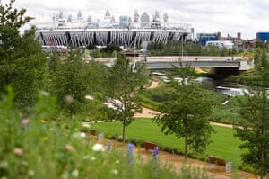 London Legacy: View of Olympic Stadium with parkland and flowers in foreground