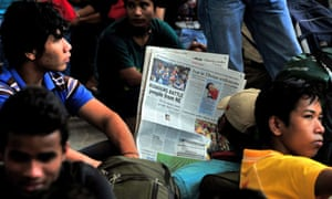 Migrants from Assam gather at Bangalore railway station amid rumours of possible violence