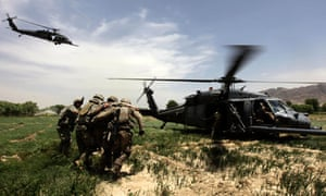 U.S. Army soldiers help an injured comrade into a helicopter in Arghandab valley near Kandahar
