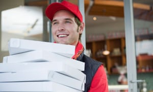 A man delivering pizzas
