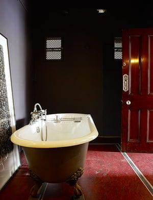 Homes: Bathroom: Roll top bath with plum coloured walls