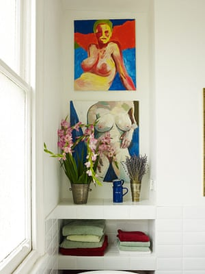 Homes: Bathroom: Paintings and flowers decorating a bathroom