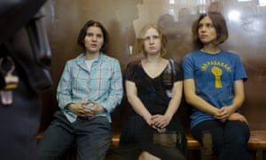 Here are the feminist punk group Pussy Riot members, Nadezhda Tolokonnikova, right, Maria Alekhina, center, and Yekaterina Samutsevich, sitting in a glass cage in the court room in Moscow, awaiting the verdict.