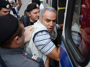 Russian riot police detain opposition leader Garry Kasparov outside the Pussy Riot trial building.