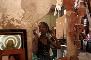 From the agencies: Marie Ellen da Silva fixes her hair