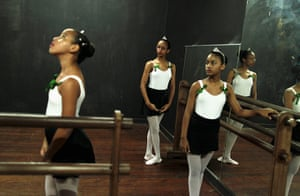 From the agencies: Girls take instructions during their ballet class