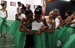 From the agencies: Girls fit their ballet skirts during their ballet class