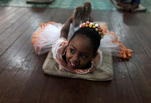 From the agencies: A girl stretches on the floor