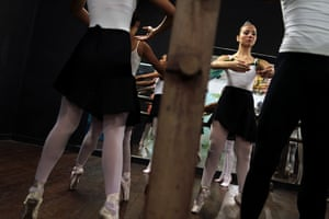 From the agencies: Girls performs during their ballet class