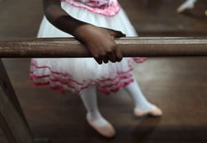 From the agencies: A girl warms up on the barre