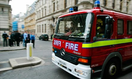 A fire engine heads to London's Aldgate
